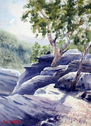 A Watercolour artwork by Joe Cartwright in the Realist Impressionist style  depicting Landscape Rocks and Trees with main colour being Blue Olive and Purple and titled At the end of Cabbage Tree Road