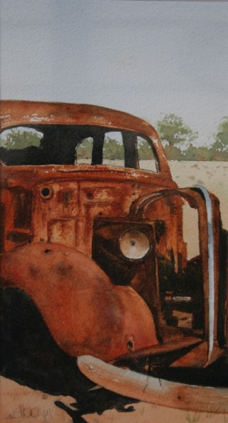 A Watercolour artwork by Sharon Moroney in the Realist Impressionist style  depicting Landscape Cars with main colour being Black Brown and Orange and titled Rust and Dust
