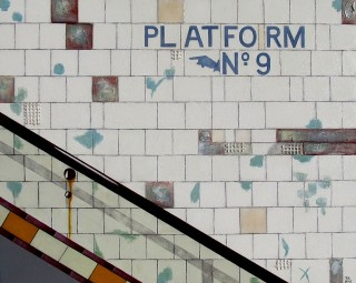 A Mixed Media artwork by Pauline Bailey in the Contemporary Realist style  depicting  Buildings City and Interior with main colour being Grey and titled Subway Platform 9