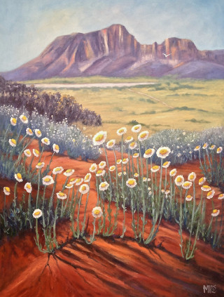 An Oil  painting  by Australian artist Moyra Le Blanc Smith in the Realist Impressionist style  depicting Flowers, Bush and Mountains with main colour being Cream and Orange and titled Rainbow Valley