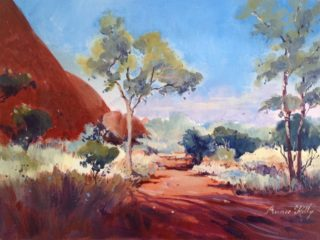 An Acrylic painting by Annee Kelly in the Impressionist style  depicting Landscape Outback Rocks and Trees with main colour being Blue Brown and Ochre and titled Mystical Land, NT