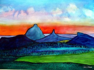 A  painting by Valarie Ross depicting  Mountains and Sunrise with main colour being Blue Orange and Red and titled sunrise over Glasshouse Mtns