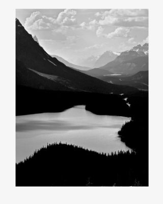 A  photograph by Philip Bell depicting Landscape Lake and Mountains with main colour being Black Grey and White and titled Star Lake