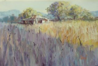 A Pastel painting by Penelope Gilbert-Ng in the Impressionist style  depicting Landscape Rural and Sheds with main colour being Blue Brown and Cream and titled Afternoon Shadows