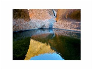 A  photograph by Philip Bell Water with main colour being Black Blue and Brown and titled Uluru Light Pool 1