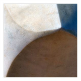 A  photograph by Philip Bell with main colour being Blue Brown and Cream and titled Pilliga Marble Axe