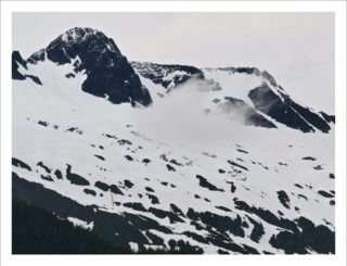 A  photograph by Philip Bell depicting Landscape Mountains and Snow with main colour being Black and White and titled White Pass Alaska
