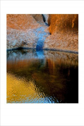 A  photograph by Philip Bell depicting Landscape Water with main colour being Blue Brown and Ochre and titled Uluru Light Pool III