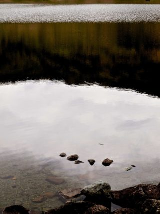 A  photograph by Philip Bell Water with main colour being Grey and titled Wordsworths Tarn