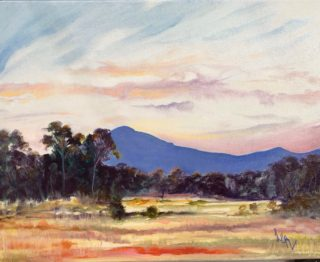 An Oil painting by Lesley Rosochodski in the Impressionist style  depicting Landscape Bush Farmland and Rural with main colour being Blue Cream and Gold and titled View of Sunset Towards Mt Macedon