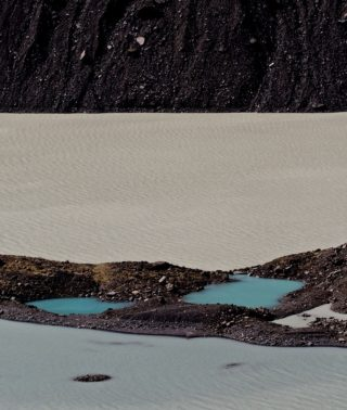 A  photograph by Philip Bell depicting Water Lake with main colour being Blue Brown and Grey and titled Moraine Lake NZ