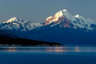A  photograph by Philip Bell depicting Landscape Mountains with main colour being Blue and titled Mt Cook dusk