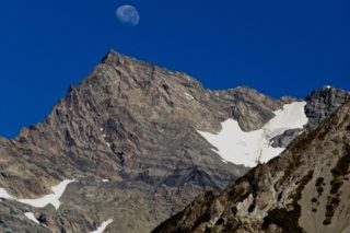 A  photograph by Philip Bell depicting Landscape Moon and Mountains with main colour being Blue and Grey and titled NZ Moon