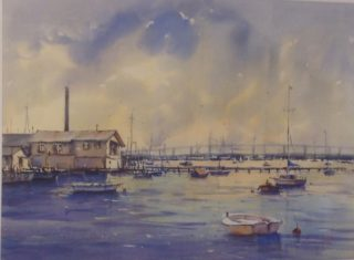 A Watercolour artwork by Annee Kelly in the Impressionist style  depicting Landscape Boats and Water with main colour being Blue Grey and Pink and titled Golden Glow, Williamstown