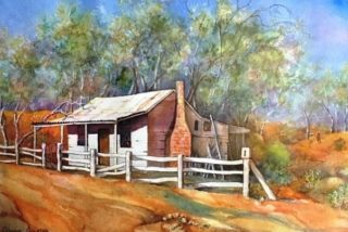 A Watercolour artwork by Glenys Gaston in the Contemporary Realist style  depicting Landscape Buildings with main colour being Brown Gold and Orange and titled Outback Colours
